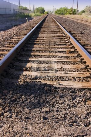 Railroad Tracks stock photo, Close up on Railroad Tracks by Mehmet Dilsiz