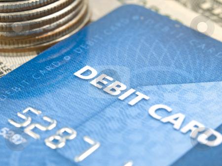 Narrow focus of debit card with money stock photo, Narrow focus of debit card with money by John Teeter