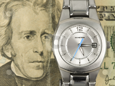 Time is money stock photo, Time is money concept with cash and watch by John Teeter