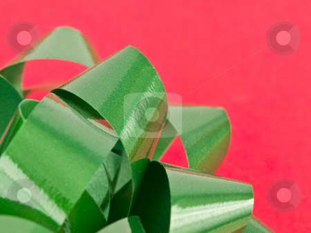 Close up of green bow stock photo, Close up of Green bow on christmas wrapping paper by John Teeter