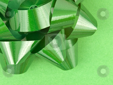Close up of Green Bow on Wrapping paper stock photo, Close up of Green bow on christmas wrapping paper by John Teeter