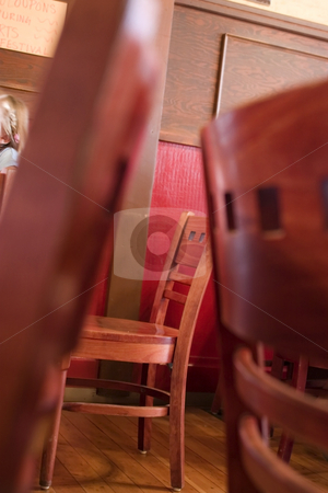 Restaurant Life in between Chairs stock photo, Chairs in a Restaurant with a Two Chairs forming a Frame by Mehmet Dilsiz