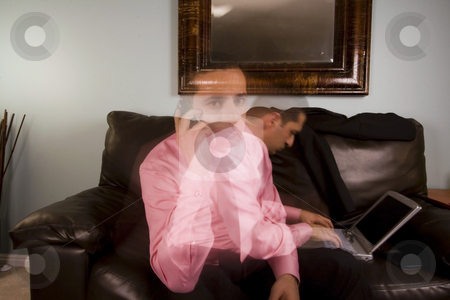 Home or Office - Businessman Multitasking stock photo, Home or Office - Businessman Multi-tasking on the Couch by Mehmet Dilsiz
