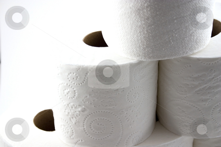 Close up on Isolated Toilet Papers forming a Pyramid stock photo, Roll of Toilet Papers Stacked up On Top of Each Other - Isolated Close up by Mehmet Dilsiz