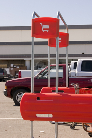 Shopping Cart Return Signs stock photo, Shopping Cart Signs in the Parking Lot by Mehmet Dilsiz