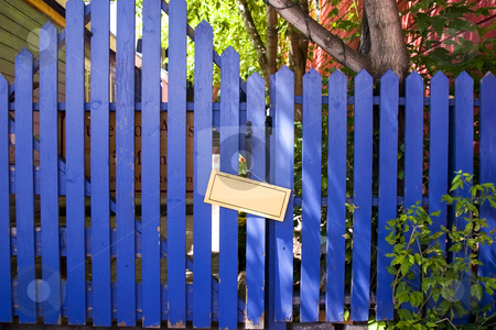 Blue Fenced Door with a Blank Sign stock photo, Blue Wooden Fence Door with a Blank Sign by Mehmet Dilsiz