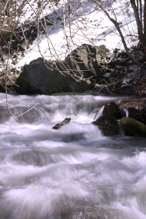 River during Spring stock photo, Flowing water in River by Mehmet Dilsiz