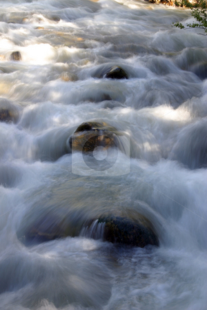 River stock photo, Flowing water in River through the rocks by Mehmet Dilsiz