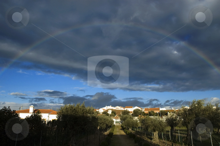 Rainbow  stock photo, Rainbow over a small village in Alentejo, Portugal by Manuel Ribeiro