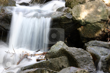 Small Waterfall stock photo, Small Waterfall in a Creek by Mehmet Dilsiz