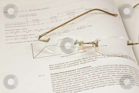 Glasses and the Statistics (DOF) stock photo, Glasses and the Stats (DOF) by Mehmet Dilsiz