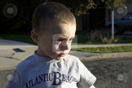 Little Boy Looking Serious stock photo, Little Boy Looking Pretty Serious by Mehmet Dilsiz