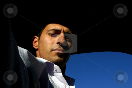 In the Sun - Self Portrait  stock photo, In the Sun by Mehmet Dilsiz
