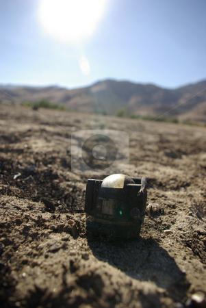 Crash Debris 2 stock photo, A compass found among debris from an airplane crash site. by Kristine Keller