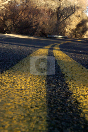 Country Road stock photo, An extremely low-angled view of a country road in Kern Country, California. by Kristine Keller