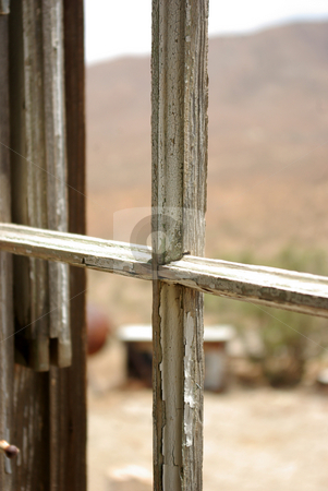 Abandoned Home 1 stock photo, Glassless window in an abandoned home in the Mojave Desert by Kristine Keller