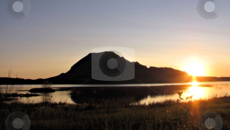 Sunrise Over Bear Butte Lake stock photo, Taken Between Sturgis And Newell In South Dakota And Was Shot From Across Bear Butte Lake! by Brian Meyer