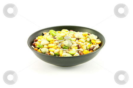 Soup Pulses in Small Black Bowl stock photo, Assorted soup pulses in a small black bowl on a white background by Keith Wilson