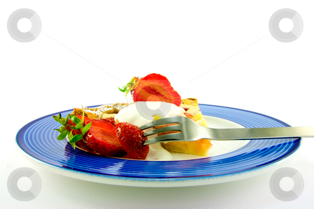 Pie with Strawberries and Cream stock photo, Slice of apple and strawberry pie with strawberries, cream and a fork on a blue plate with a white background by Keith Wilson