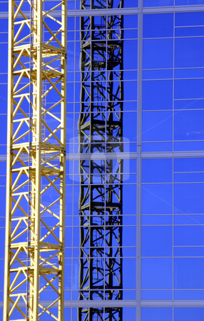 Construction Crane stock photo, Construction site- Zoomed in by Mehmet Dilsiz