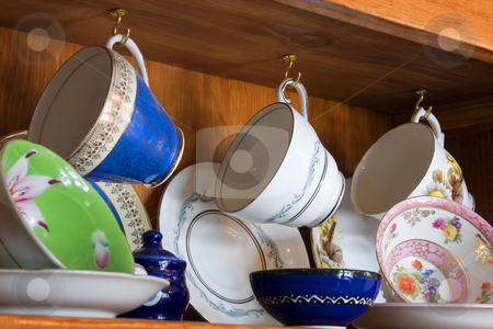 China Cabinet full of Cups stock photo, Tea and Coffee Cups by Mehmet Dilsiz