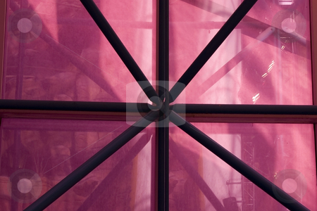 Building Support Bars with Pink Background stock photo, Symmetrical Support Bars in a Dome by Mehmet Dilsiz