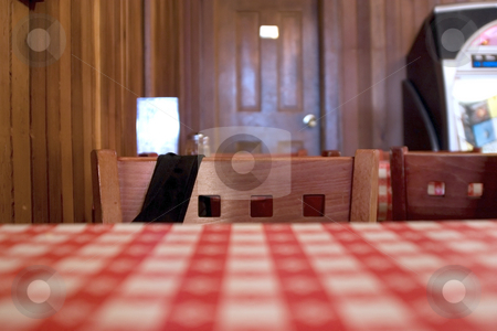 Inside a Restaurant - Close up on the Table and Chairs stock photo, Inside a Restaurant - Close up on the Checkered Table and Chairs by Mehmet Dilsiz