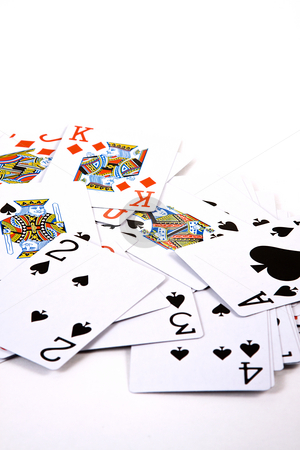 Playing Cards stock photo, Isolated - Playing Cards Spread on the Table by Mehmet Dilsiz