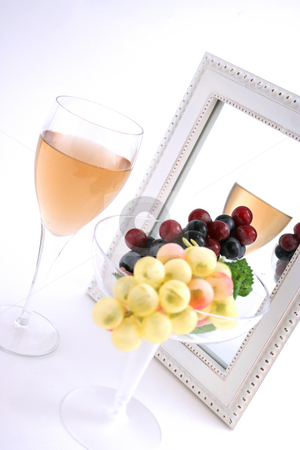 Isolated Grapes In a Glass stock photo, Isolated Grapes In a Glass in front of a Mirror with a Glass of Wine by Mehmet Dilsiz