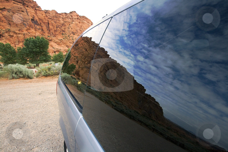 Reflection of Skies with Redrocks on the Background - Travel Con stock photo, Snow Canyon in St. George, Utah - Trave Concept by Mehmet Dilsiz