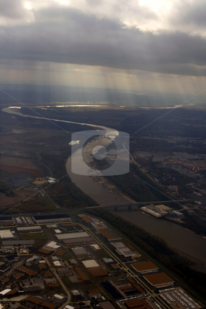 Looking down the Plane stock photo, Aerial Shot from the Airplane with Sunrays coming through the clouds by Mehmet Dilsiz