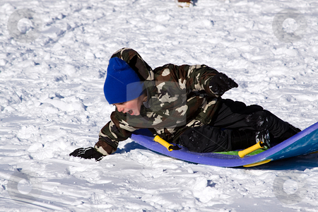 Little Boy Sledding down the Hill stock photo, Little Boy Sledding down the Hill - Winter Scenes by Mehmet Dilsiz