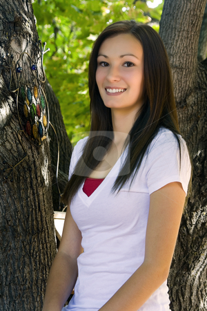 Beautiful Teenager with Trees in the Background stock photo, Close up on a Beautiful Teenager with Trees in the Background by Mehmet Dilsiz