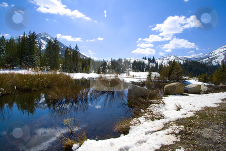Mountains, River and Snow in the Spring stock photo, Rural Scene of a Canyon with Mountains, River and Snow in the Spring by Mehmet Dilsiz