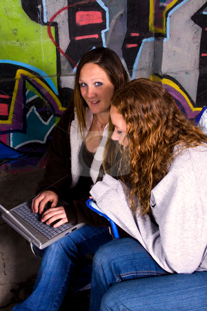 Girls with a Laptop stock photo, Girls with a Laptop - Graffiti Background by Mehmet Dilsiz