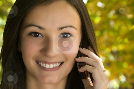 Beautiful Girl Talking on the Phone stock photo, Close up on a Beautiful Girl Talking on a Cell Phone by Mehmet Dilsiz