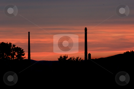 Mountains and the Silos as Sihoutte stock photo, Sihoutte at Sunset with Mountains and Silos on the Background by Mehmet Dilsiz
