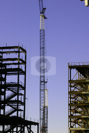 Construction Site & the Crane stock photo, Construction site& the Crane- Zoomed in by Mehmet Dilsiz