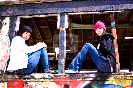 Beautiful Two Teenagers stock photo, Beautiful Two Teenagers Sitting in an Old Train by Mehmet Dilsiz
