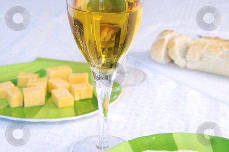 Cheese on a Plate with the Wine Glass in Focus stock photo, Close up - Cheese on a Plate with the Wine Glass in Focus by Mehmet Dilsiz