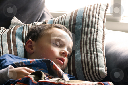 Cute Little Boy Sleeping on the Couch stock photo, Little Boy Sleeping on the Couch by Mehmet Dilsiz