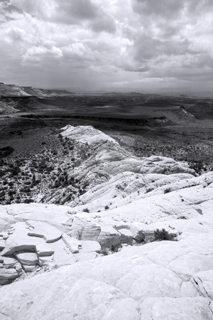 Looking down the Sandstones in to Snow Canyon stock photo, Snow Canyon in St. George, Utah - Sandstones - Black and White by Mehmet Dilsiz