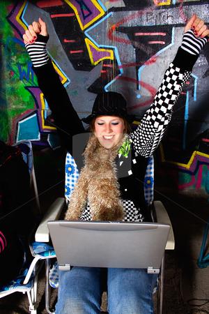 Happy Girl with Laptop stock photo, Happy Girl with Laptop Urban Scene by Mehmet Dilsiz