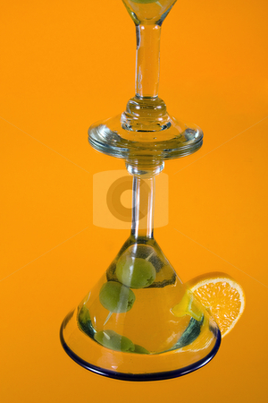 Martini Glass on a Mirror stock photo, Martini Glass - Isolated on Orange Background by Mehmet Dilsiz