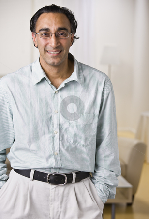 Indian Man stock photo, An attractive Indian man posing.  He is dressed in business attire and is smiling at the camera.  Vertically framed shot. by Jonathan Ross