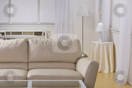 Empty Living Room stock photo, A living room decorated in neutral tones.  Horizontally framed shot. by Jonathan Ross