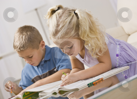 Young Children Coloring stock photo, A brother and sister coloring together.  Horizontally framed shot. by Jonathan Ross
