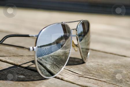 Sunglasses stock photo, Sunglasses on a bridge reflecting the sun by Fredrik Elfdahl