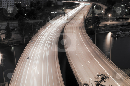 Moving lights stock photo, Cars driving by night by Fredrik Elfdahl