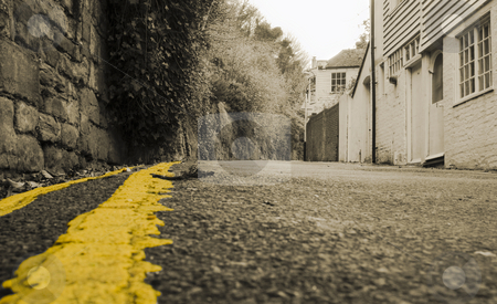 Yellow road stock photo, Old gravel road with yellow stripe by Fredrik Elfdahl
